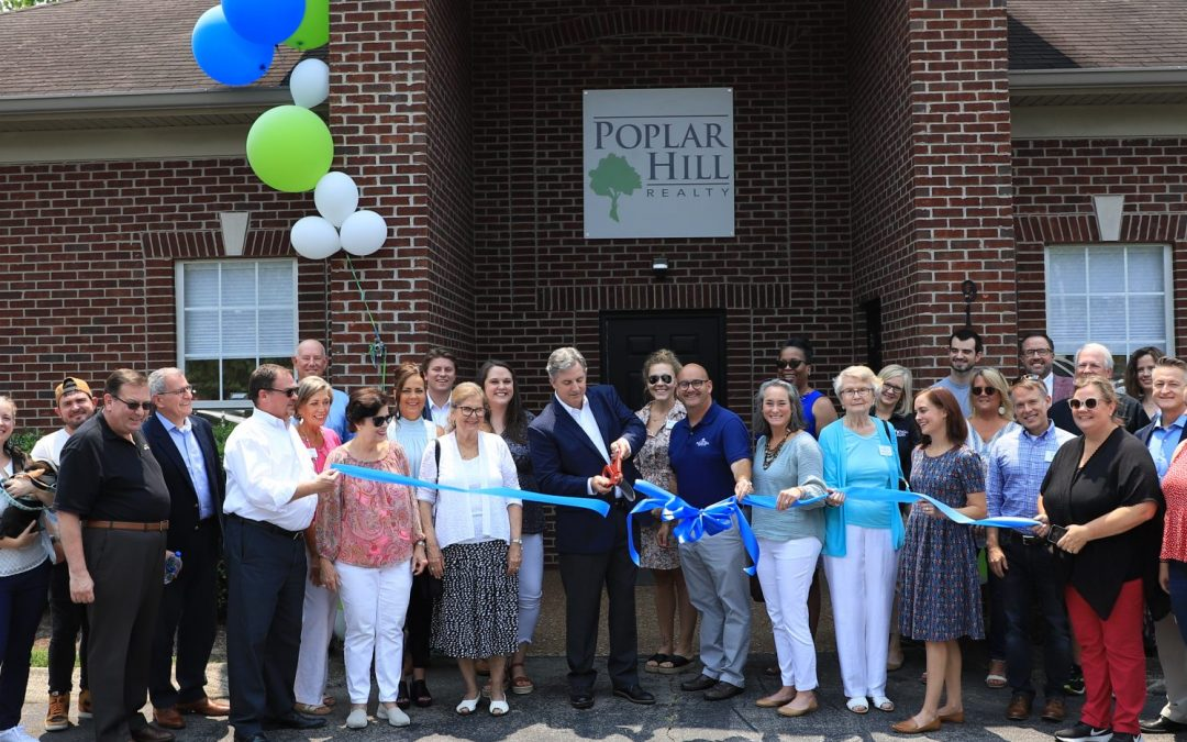 Own It!  Poplar Hill Realty Opens New Headquarters